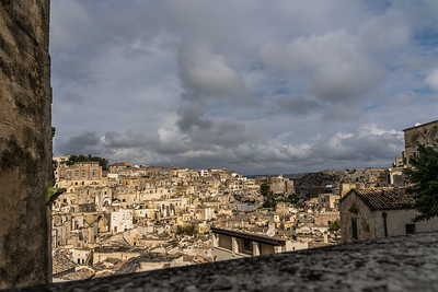 A view of the Sassi from the upper flat part of Matera with a view of the old cave dweilling across the gorge.