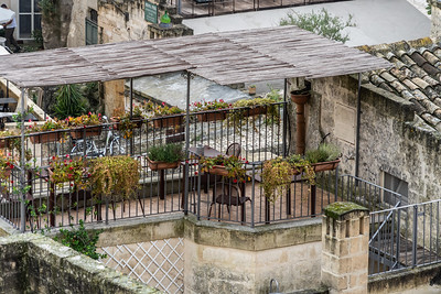 A lovely terrace in the Matera Sassi. with lots of plants which is typical here on terraces.