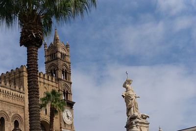 Another view of the exterior of the Palermo Cathedral with the statue of Santa Rosalia in the foreground
