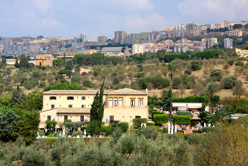 Villa Athena hotel with city of Agrigento up on hilside.
