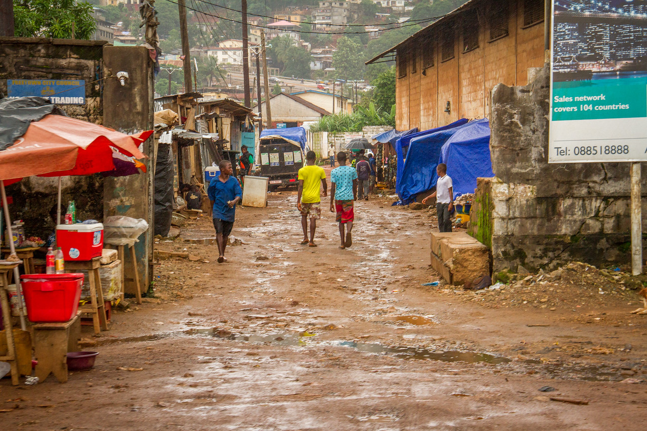 The streets of Sierra Leone are full of juxtapositions like these bright colors against earthy tones