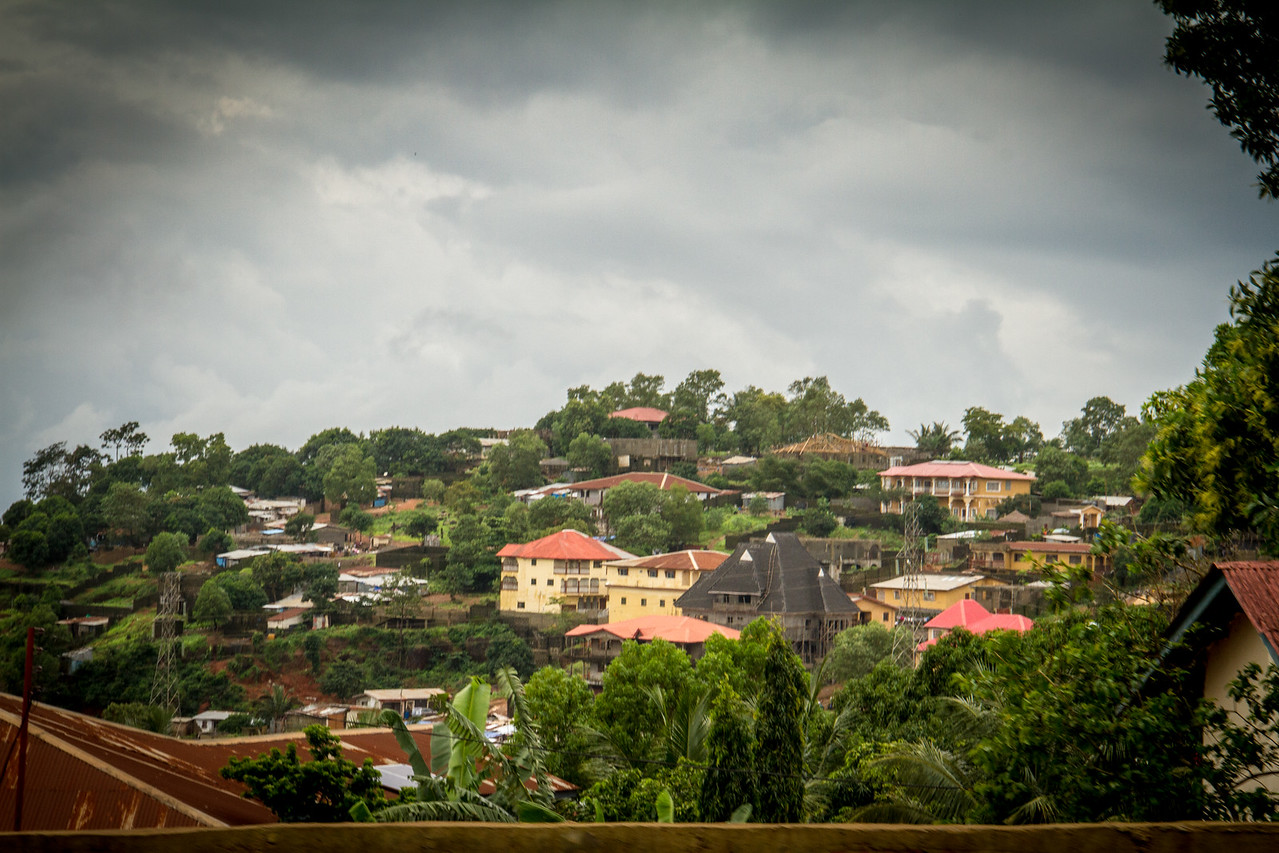 What's interesting about the photos of the Sierra Leone hillsides is the luxurious homes next to shacks and incomplete structures.
