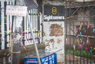 Sightsavers is a UK-based international charity which fights avoidable blindness and promotes equal opportunities for visually impaired people.  I am not sure what the ribbons signify but they look like wish ribbons and are often tied to church gates.