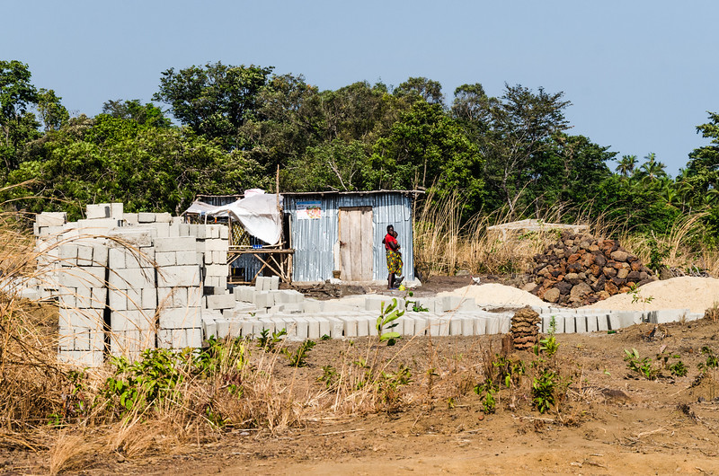 Cement blocks and a pile of stones used for house building.