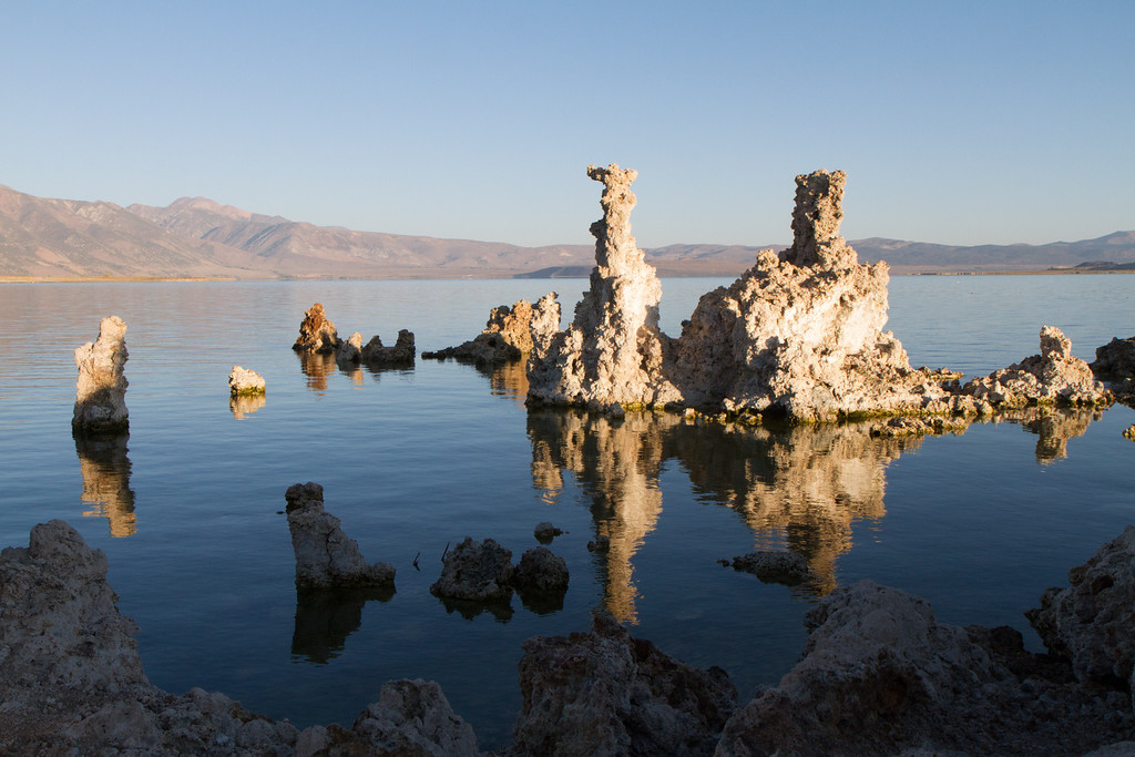 Tufas are sort of lake stalagmites, formed when mineral springs in the much deeper lake erupted into the lake water, and the minerals precipitated out and deposited at the spring vent
