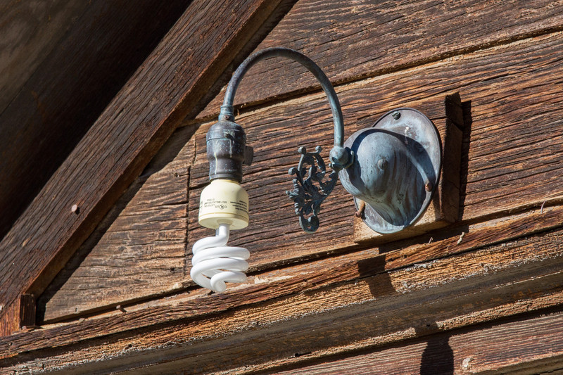 Old and new- flourescent lamp in old fixture.