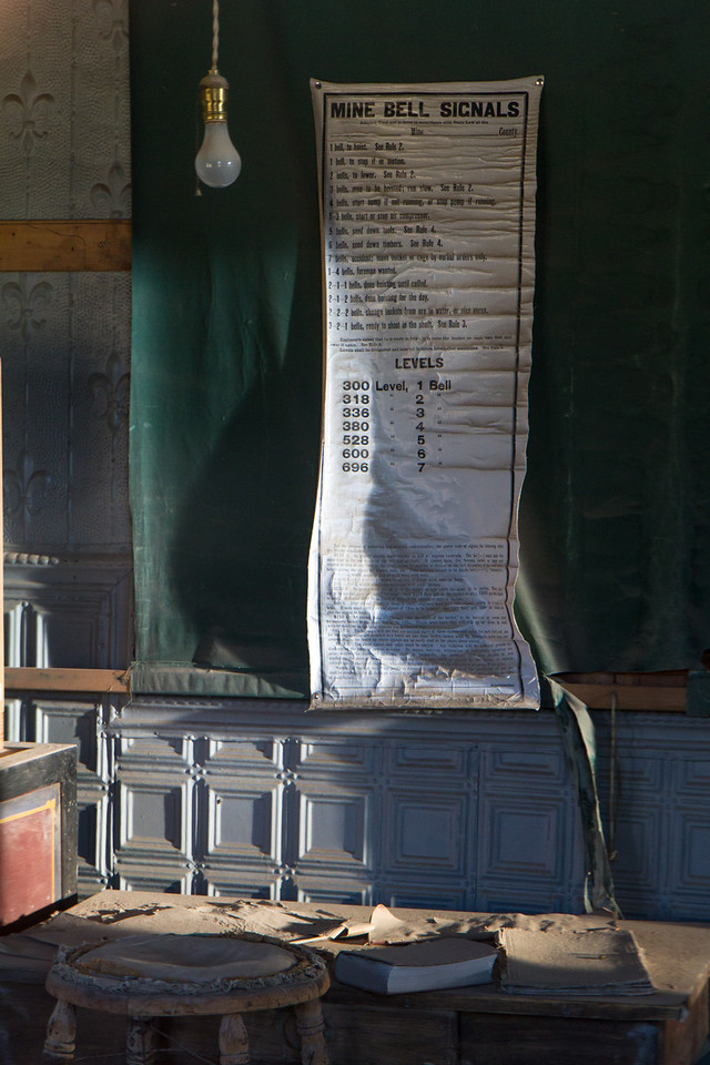 Many interiors are eerily preserved, including this one that has a list of mine bell warnings