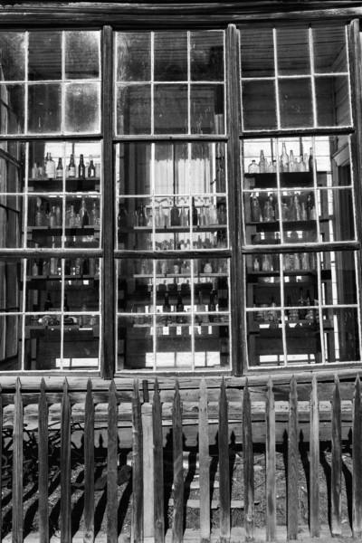 Original bottles in window front of store.