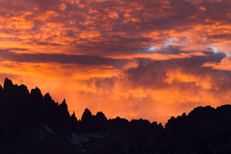 "Near Mammoth lakes is a turnout for a viewpoint overlooking some of the most dramatic peaks in the Sierras. We went there every night at sunset to see what the spectacular sky would bring that night. The ragged peaks in theses photos are called the ""Minarets"". The colors you see here have not been altered or amplified."