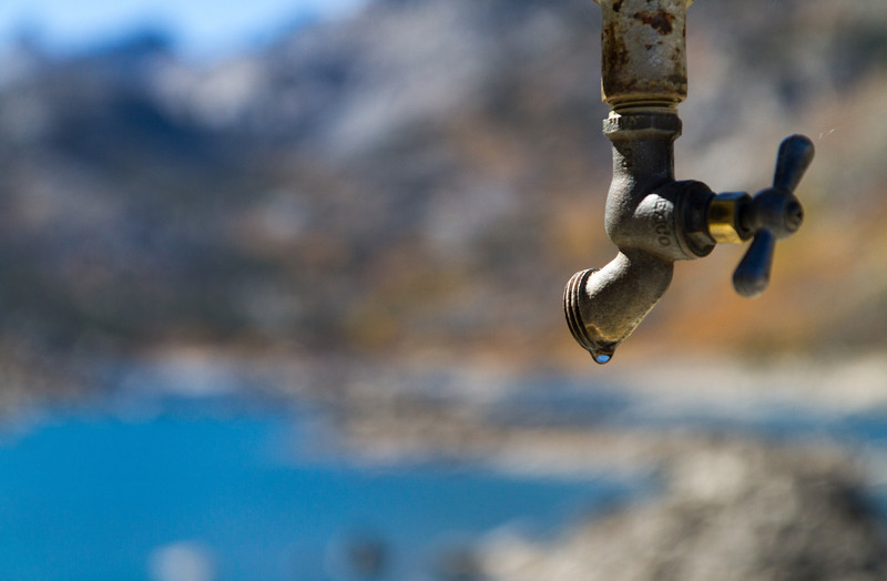 Spigot on railing of dam over South Lake, which has very low water levels.