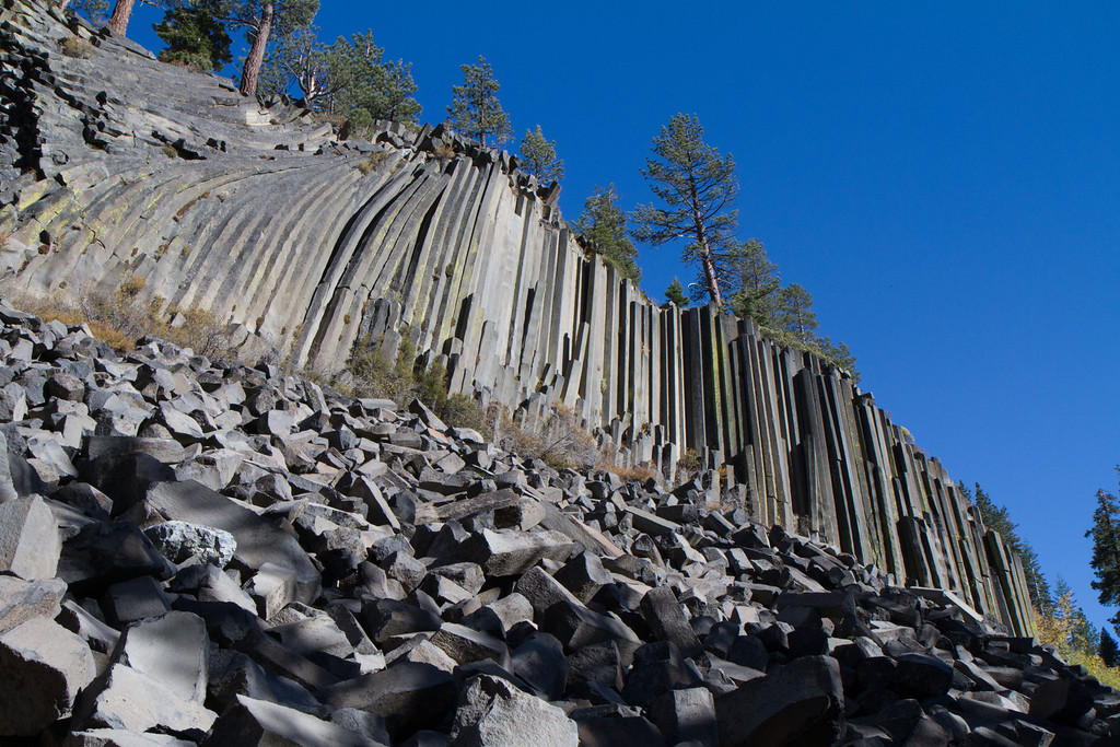 Devil's Postpile, with some of the columns breaking off and crashing to the ground below.