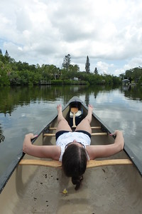 Diane taking a siesta in the canoe while Mike rows.
