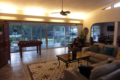 The living room with the lanai attached overlooking the canal.