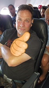 Doug on the plane (had to blur out what his hand was actually doing).