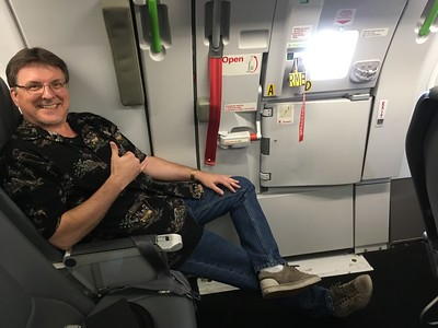 Mike's extra long leg room on the airplane.