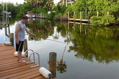 Doug testing out the fishing rods on the dock.