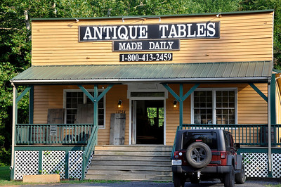 Antiques.........made daily.  I thought these signs only existed in Maine.