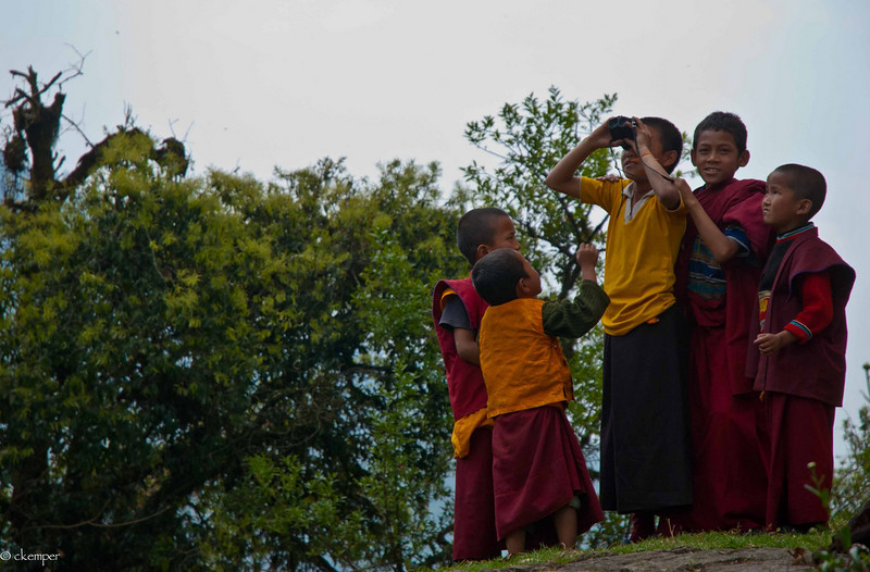 Young Monks with binoculars