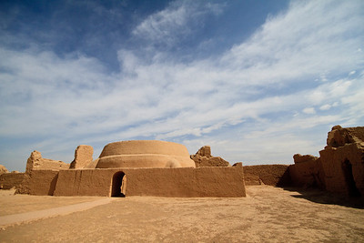 Gaochang ancient city.  Gaochang (Chinese: 高昌; pinyin: Gāochāng) is the site of an ancient oasis city built on the northern rim of the inhospitable Taklamakan Desert in Xinjiang, China. A busy trading center, it was a stopping point for merchant traders traveling on the Silk Road. The ruins are located 30 km southeast of modern Turpan.