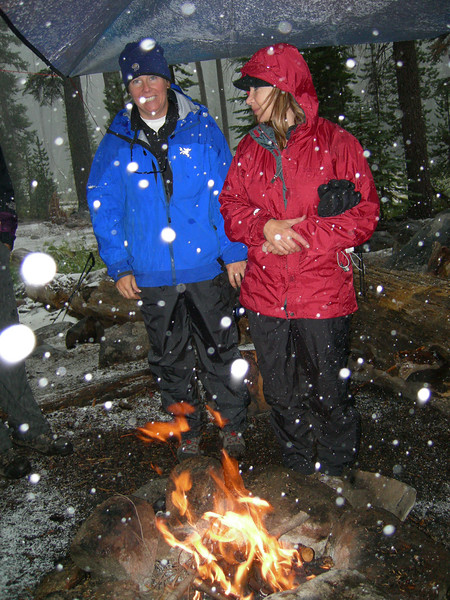 Karen and Cynthia huddle over fire