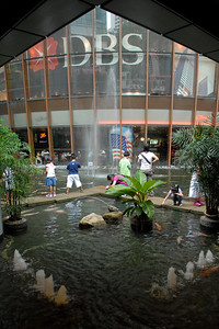 "DBS. The Fountain of Wealth (Chinese: 财富之泉), Singapore.  The Guinness Book of Records in 1998 listed this as the largest fountain in the world. Located in one of Singapore's largest shopping malls, Suntec City, at regular intervals, the fountain is turned off and visitors are invited to walk around a mini fountain at the centre of the fountain's base for good luck. At night, the fountain is the setting for laser performances, as well as ""live"" song and laser message dedications."