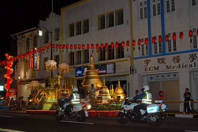 Police escort floats on Vesak Festival, Chinatown. On 30th May, 2007, The Buddha Tooth Relic temple which is the biggest Buddhist temple in Singapore was re-opened after renovation. The temple is dedicated to Maitreya Buddha, and it houses the Sacred Buddha Tooth Relic.   Singapore's Chinatown is an ethnic neighbourhood featuring distinctly Chinese cultural elements and a historically concentrated ethnic Chinese population although it also houses many other religious places such as the Hindu Sri Mariamman Temple and Jamae Mosque.