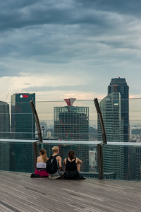 Visitors soaking in the view at the Sands SkyPark Observation Deck, observation deck on the 57th floor offering panoramic city views of Singapore.