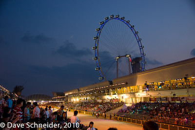 In the background are the Singapore Flyer ferris wheel and the Marina Bay Sands.