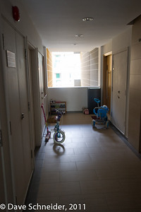 The hallway is always filled with bikes, tricycles and shoes. I like that better than the buildings with empty hallways!!