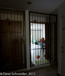 There's a gate in front of every door. You leave your door open and lock the gate in order to get a breeze going. The 3 & 5 year-olds next door wave and yell Hi whenever they pass. I think they think they're visiting weird zoo specimens! Notice the shoe cabinet on the right before the door. We have to keep it open a crack, although I'm sure it's bad feng shui. Otherwise it might melt down like a nuclear reactor.