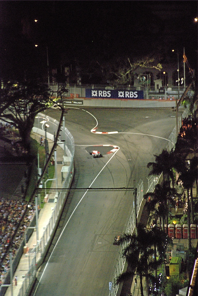 Jarno Trulli keeps out of the way on turn 10 as his car grinds to a halt