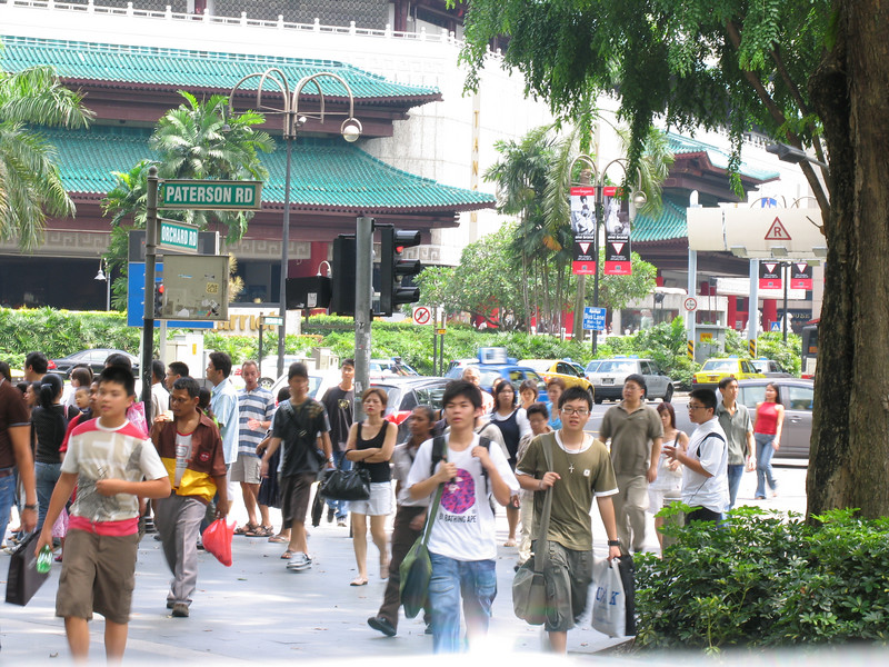 Shopping crowds crossing the Scott Rd/Orchard Rd junction.