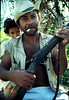 This man hunts monkeys with this black power shot gun. It is hand made. The firing pin is a inner tube,A spring-loaded nail hits the shell and fires. He feeds his family this way. He would be called a Cabocalo, meaning of mixed black, and Native race.