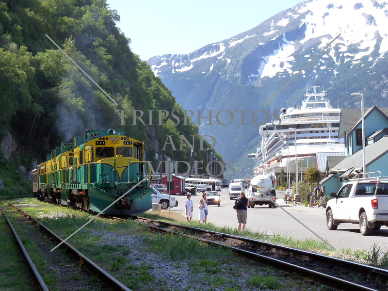 A train and a cruise ship docked at the port in Skagway, Alaska.
