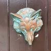 A fox head knocker on a door in Glencoe