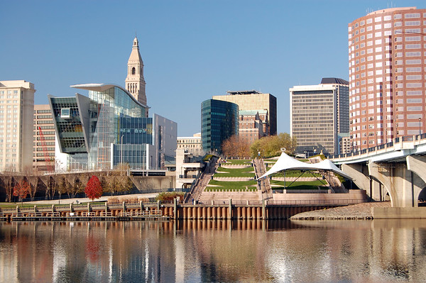 Hartford, Connecticut skyline on an autumn day. Connecticut River in the foreground.