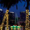 Orlando skyline at twilight during the Christmas holidays. Lake Eola and fountain in foreground.