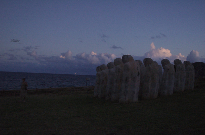 Another view of the figures silently facing the Caribbean.