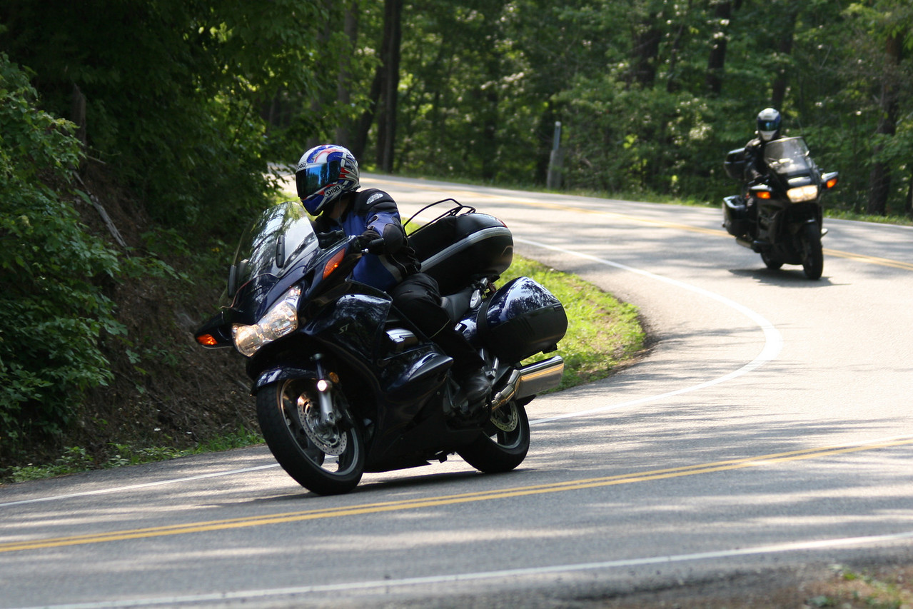 Here's Rich, and me bringing up the rear.  Notice me looking into the turn and not where I'm heading.  Nice job Honda.