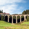 A train that passes only once a day, cutting through the green heart of Slovakia. <br /> <br /> Chmarošský Viadukt, Slovak Paradise.