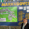 I am standing in front of the tourist sign for Markušovce.
