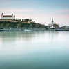 Bratislava castle, Danube river and parliament at twilight. Bratislava is a capital of Slovakia, Europe