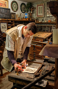 A printer demonstrates old arts in Castle Bled