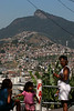 Residents stand near a viewpoint of the Christ the Redeemer statue in the Providencia slum in Rio de Janeiro, Brazil, August 18, 2005. Recent public works in the slum in central Rio, which include paving and water, also include a tourist route. Along with traditional tourist sites such as beaches, the Christ statue and Sugaloaf mountain, Rio's famous slums, which offer spectacular views of the city, are becoming a regular tourist stop.  (AustralFoto/Douglas Engle)