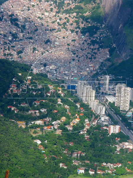 A view of the Rocinha slum and the fashionable Sao Conrado district of in Rio de Janeiro, Brazil, January 9, 2004. Along with traditional tourist sites such as beaches, the Christ statue and Sugaloaf mountain, Rio's famous slums, which offer spectacular views of the city, are becoming a regular tourist stop. (AustralFoto/Douglas Engle)