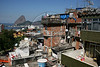 The Sugarloaf mountain is seen from a hotel in the Taveres Bastos slum in Rio de Janeiro, Brazil, August 18, 2005. Along with traditional tourist sites such as beaches, the Christ statue and Sugaloaf mountain, Rio's famous slums, which offer spectacular views of the city, are becoming a regular tourist stop. (AustralFoto/Douglas Engle)