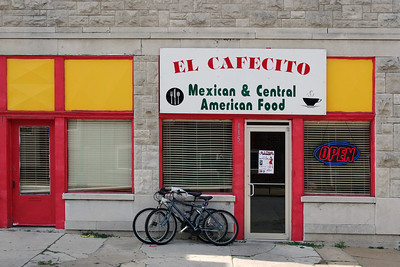 """El Cafecito Mexican and Central American restaurant in Carthage, Missouri. Our massive burritos were pretty good - with Rita's steak beating out my chicken. Interesting salsas, too - both red and green. """"Coffee"""" was 2 styro cups of hot water, a large spoon, and a plastic jar of Taster's Choice """"crystals"""".  You'll find this 3rd world treasure in Carthage just south of 96 (Central Avenue) at 115 S Main. Don't miss the equally exotic Panaderia El Quetzal bakery a few doors to the south (left, in this photo)."""