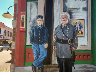 Historical murals painted on shop walls in Mount Vernon, Missouri.
