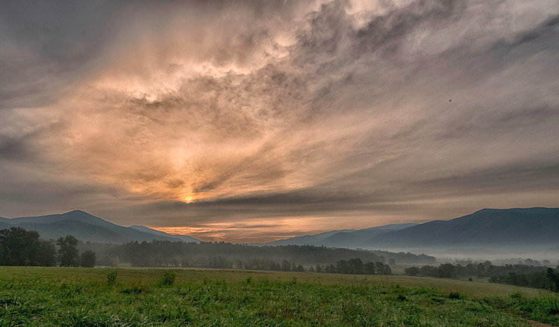 Cades Cove National Park, About 35 minutes after sunrise, the sun was peeking over a bit of low cloud cover and lighting up the cove.