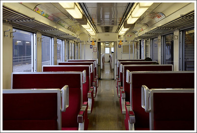 The inside of a local train that took us the last few stops.  You only see this kind of train in the countryside.  In the city, they leave much more room for standing.